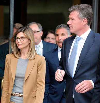 Lori Loughlin et al. posing for the camera: Actress Lori Loughlin exits a courthouse  on April 3 after facing charges for allegedly conspiring to commit mail fraud and other charges in the college admissions scandal.