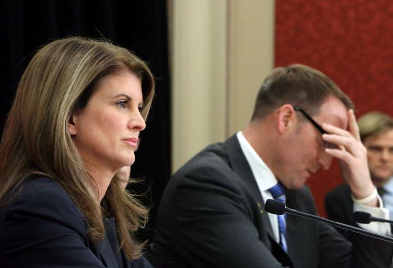 Rona Ambrose et al. looking at the camera: MacKay and Ambrose take part in a news conference about the purchase of F-35 fighter jets on Parliament Hill on Dec. 12, 2012 (CP/Fred Chartrand)