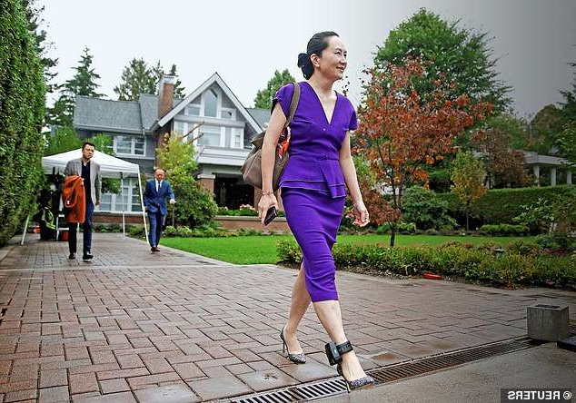 a man and a woman walking down a sidewalk: Extradition battle: Meng Wanzhou leaving her home in Vancouver with her every step monitored