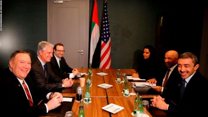 Abdullah bin Zayed Al Nahyan, Robert C. O'Brien, Mike Pompeo sitting at a table: US Secretary of State Mike Pompeo, right,  meets UAE Foreign Minister Sheikh Abdullah bin Zayed Al Nahyan, left, for bi-lateral talks prior a Peace summit on Libya in Berlin on Sunday.