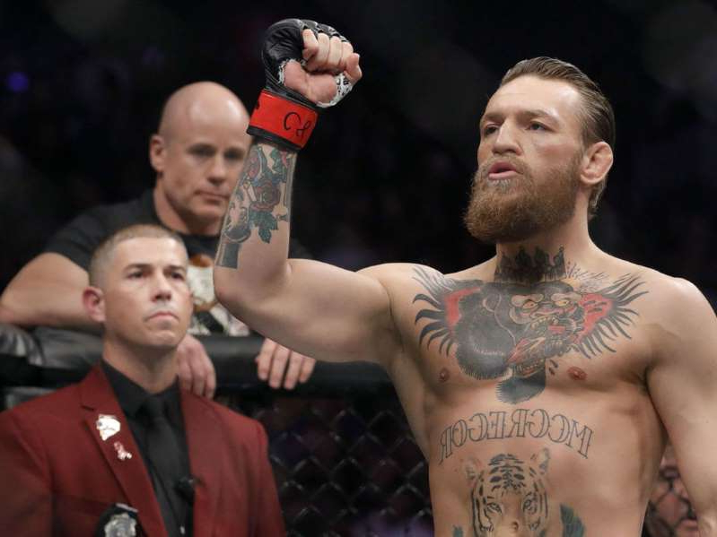 Conor McGregor holding his hands up