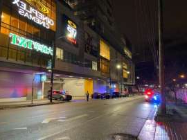 a view of a city street at night: The body was found by a passerby in the parking lot of Marine Gateway Cineplex, near South West Marine Drive and Cambie Street just before 8:30 p.m. on January 18.