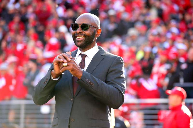 Jerry Rice wearing a suit and tie
