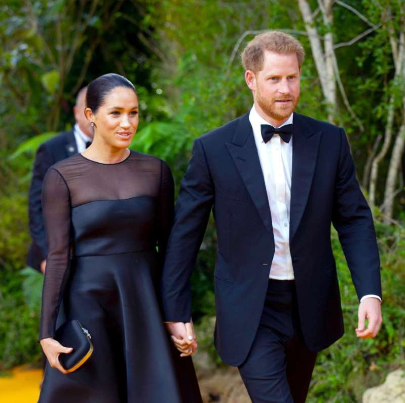 Prince Harry, Meghan Markle are posing for a picture: Prince Harry and Meghan Duchess of Sussex attend 'The Lion King' film premiere on London, UK on July 14, 2019
