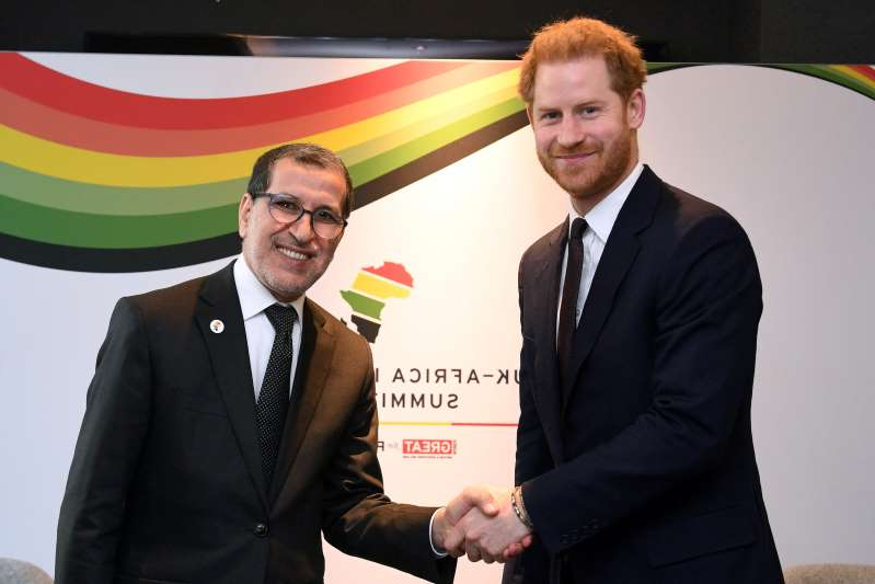 Prince Harry, Saadeddine Othmani are posing for a picture: Britain hosts Africa investment summit