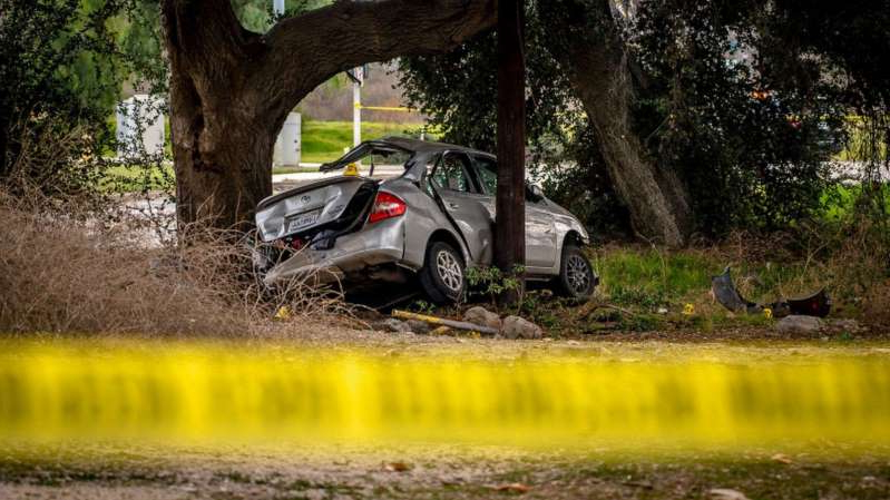 a car parked in front of a tree: This photo shows a Toyota Prius at the scene of a deadly crash in the Temescal Valley, south of Corona, California, on Jan. 20, 2020.