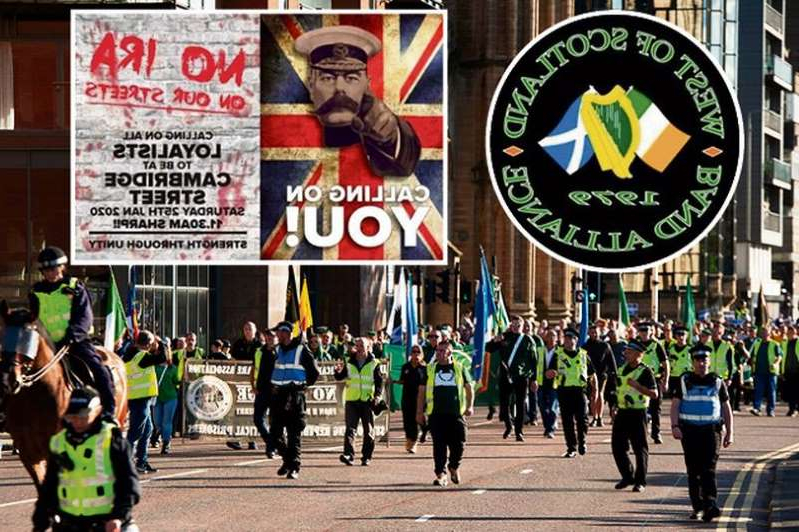 a group of people walking down the street: The National Defence League are calling for a boycott of a West of Scotland Band Alliance march in Glasgow