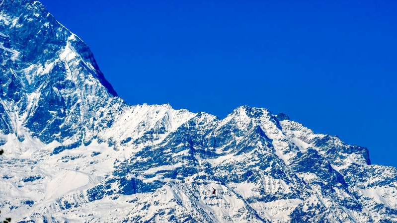 a view of a snow covered mountain: The avalanche hit part of Mount Annapurna after heavy snowfall
