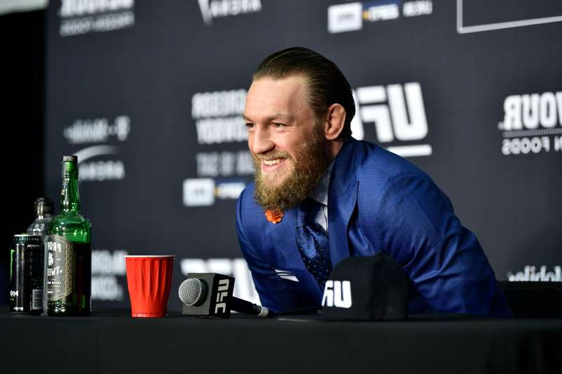 Conor McGregor sitting in front of a laptop: Just days after his win against Donald Cerrone at UFC 246, Conor McGregor already has his eyes set on his next bout. (Chris Unger/Zuffa LLC/Getty Images)