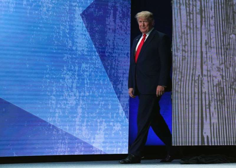 Donald Trump wearing a suit and tie: U.S. President Trump speaks at the American Farm Bureau Federation Annual Convention and Trade Show in Austin