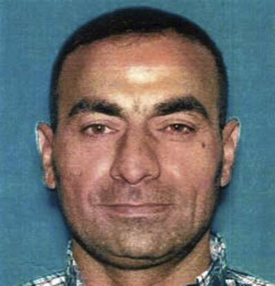 Slide 1 of 7: This undated photo provided by the U.S. Attorney's Office shows Omar Abdulsattar Ameen. The refugee from Iraq was arrested Wednesday, Aug. 15, 2018, in Northern California on a warrant alleging that he killed an Iraqi policeman while fighting for the Islamic State organization. (U.S. Attorney's Office via AP)