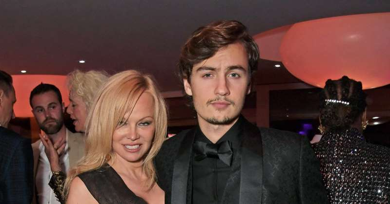 Aaron Taylor-Johnson et al. posing for the camera: Brandon Thomas Lee Says He's 'Incredibly Happy' for Mom Pamela Anderson After Surprise Wedding