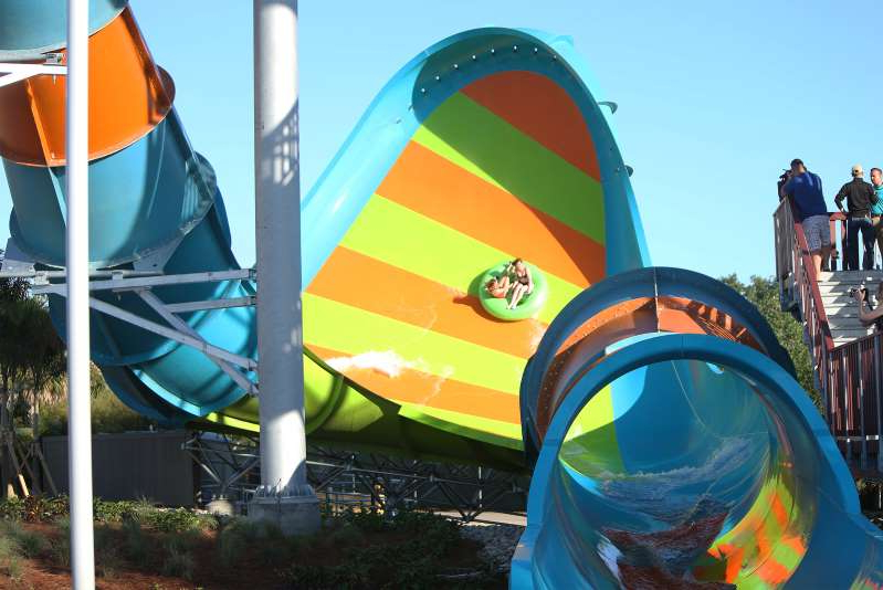 Aquatica Orlando's newest water slide, KareKare Curl, opened in April 2019. Two riders, who face each other on the raft, experience a 35-foot drop in the enclosed tube and then rush up a vertical wave wall. The ride takes about 15 to 20 seconds to complete. (Rich Pope/Orlando Sentinel/TNS via Getty Images)