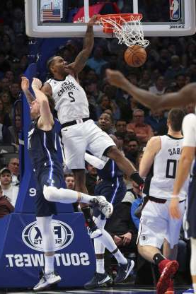 Los Angeles Clippers forward Kawhi Leonard (2) dunks the ball over Dallas Mavericks forward Luka Doncic (77) in during the first half of an NBA basketball game Tuesday, Jan. 21, 2020 in Dallas. (AP Photo/Richard W. Rodriguez)