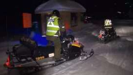 Members of the Sûreté du Québec snowmobile team were combing the area overnight after a group of tourists on snowmobiles fell through the ice.