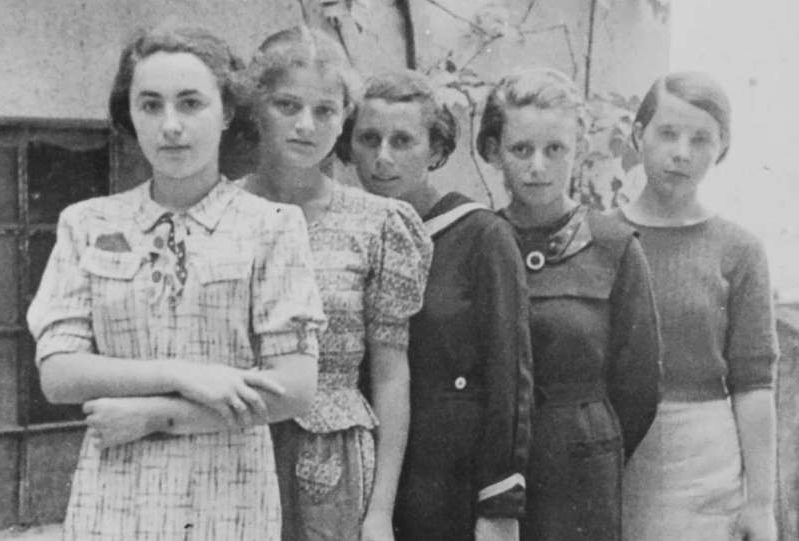 Nicole-Reine Lepaute et al. posing for a photo: Two of the five girls in this photograph—taken in Humenné, Slovakia, around 1936—are known to have been sent to Auschwitz, Poland, on March 25, 1942, as part of the first official transport of Jews to the death camp. Neither Anna Herskovic (second from left) nor Lea Friedman (fourth from left) survived.