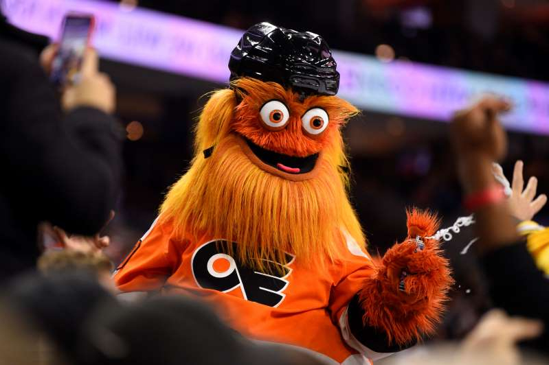 a close up of a toy: In this Jan. 13 file photo, the Philadelphia Flyers' mascot, Gritty, performs during an NHL hockey game. Police are investigating a claim that the mascot punched a 13-year-old boy in November.