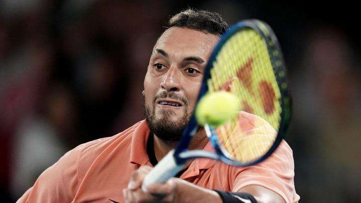 a close up of Nick Kyrgios hitting a ball with a racket: Suspended sentence: Nick Kyrgios.