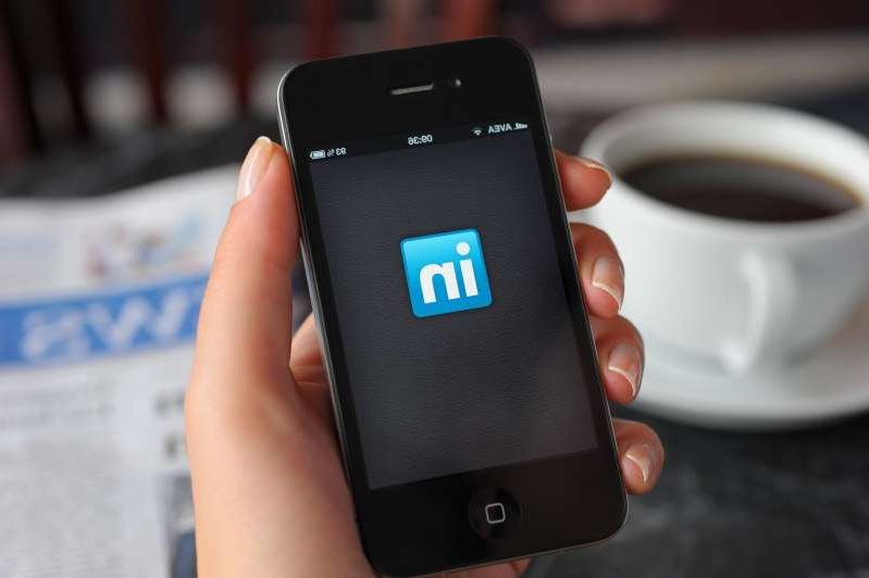a hand holding a cellphone: LinkedIn public activity can lead to awkward situations for job seekers.