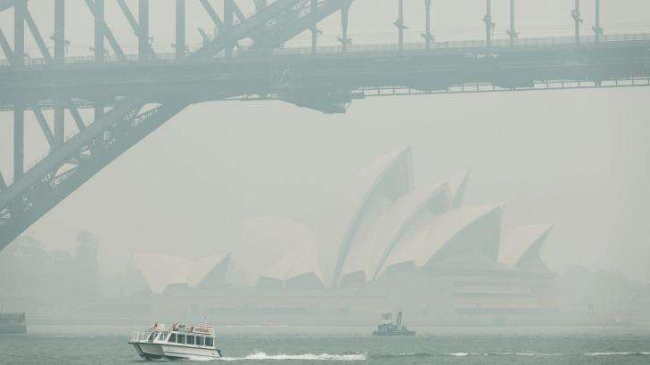 a large ship in a body of water: Sydneysiders experienced an unprecedented 28 days of hazardous air quality last year.