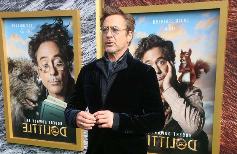 a person standing in front of Robert Downey Jr. et al. posing for the camera