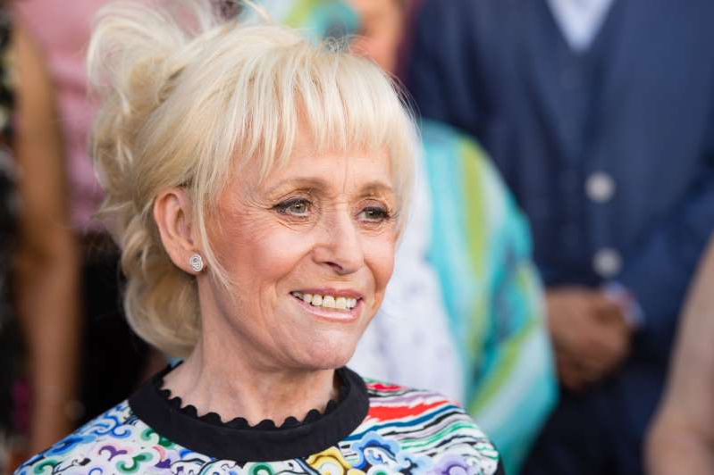 Barbara Windsor smiling for the camera: LONDON, ENGLAND - MAY 25: Barbara Windsor attends the inauguration of the Hackney Empire Walk Of Fame on May 25, 2017 in London, England. The EastEnders and Carry On films actress has been included in a 'recognition plate' on Hackney Empire's pavement together with Frank Matcham and Sir Oswald Stoll. (Photo by Jeff Spicer/Getty Images)