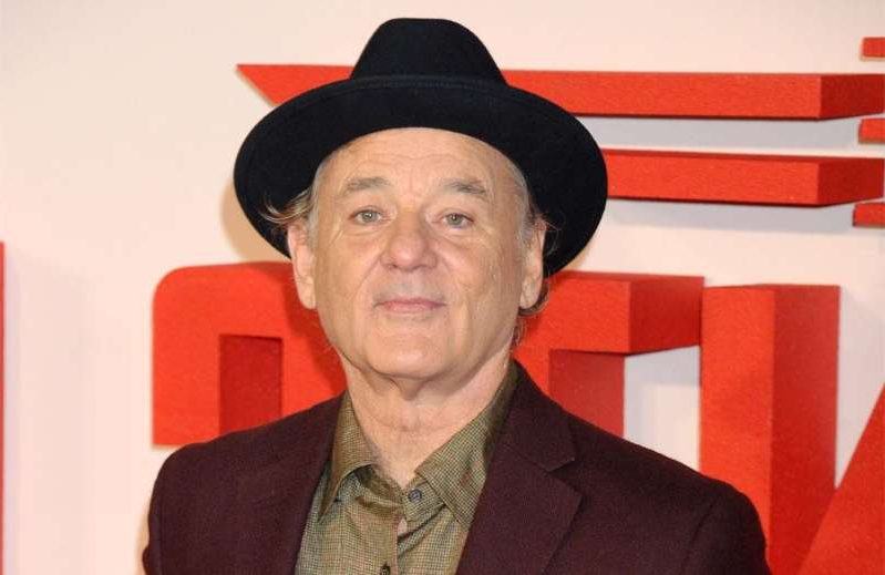 Bill Murray wearing a red hat: Dan Aykroyd