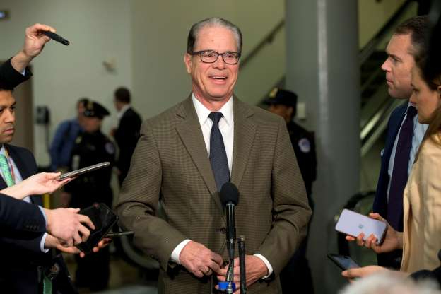 Slide 1 of 49: Sen. Mike Braun, R-Ind., speaks to reporters during the impeachment trial of President Donald Trump on charges of abuse of power and obstruction of Congress, Thursday, Jan. 23, 2020, on Capitol Hill in Washington.