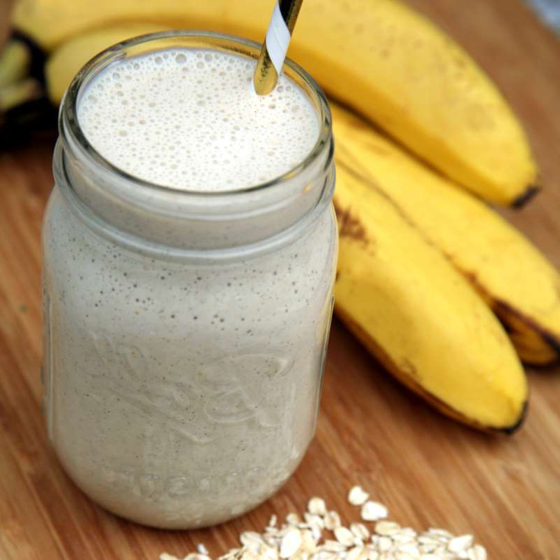 a banana sitting on top of a wooden table: If Your Smoothie Leaves You Hungry an Hour Later, Add This Dietitian-Approved Whole Grain