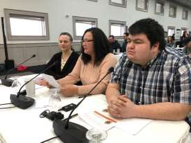 a group of people sitting at a table using a laptop: William Lines, Johanne Black and Beth Keats spoke on behalf of the Yellowknives Dene First Nation Thursday at the Mackenzie Valley Land and Water Board hearings into the Giant Mine cleanup.