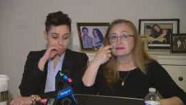 a man and a woman sitting at a table: Sahar Bahadi and Sara Ann Yatim, at a press conference on Friday, responded to the decision to grant full parole to a police officer who fatally shot the Sammy Yatim in 2013.