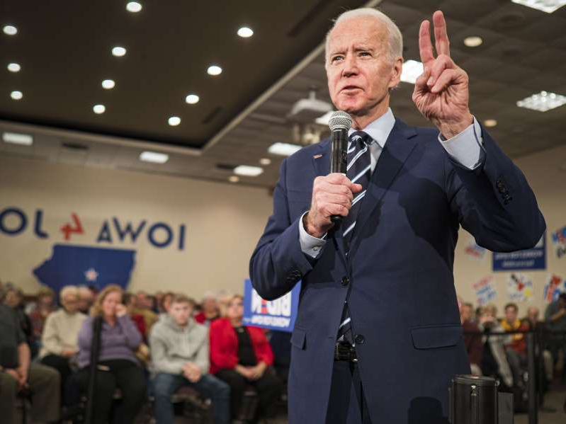 Joe Biden wearing a suit and tie standing in front of a crowd: Former US Vice President Joe Biden speaks during a campaign event at the Gateway Hotel and Conference Center in Ames, Iowa on Tuesday, Jan. 21, 2020.