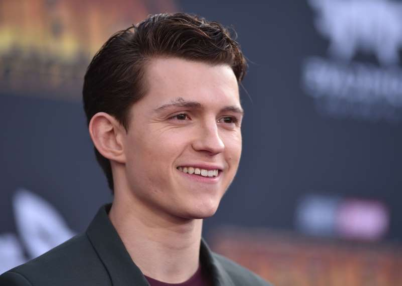 Tom Holland wearing a black shirt