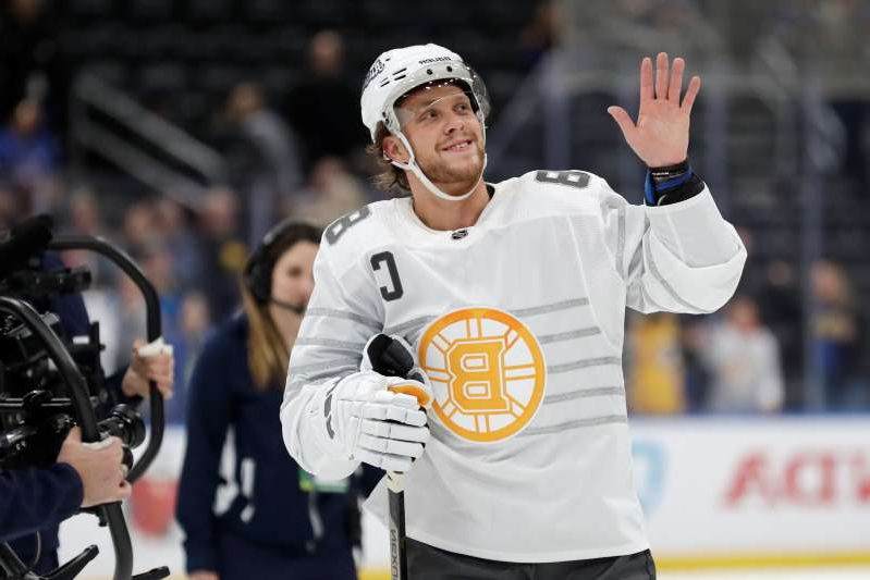 Boston Bruins forward David Pastrnak waves to the crowd as he is named the most valuable player of the NHL hockey All Star games Saturday, Jan. 25, 2020, in St. Louis. (AP Photo/Jeff Roberson)