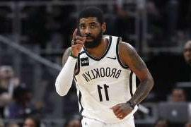 Kyrie Irving holding a basketball: Brooklyn Nets guard Kyrie Irving (11) reacts after a basket in overtime of an NBA basketball game against the Detroit Pistons in Detroit, Saturday, Jan. 25, 2020. Brooklyn won 121-111. (AP Photo/Paul Sancya)