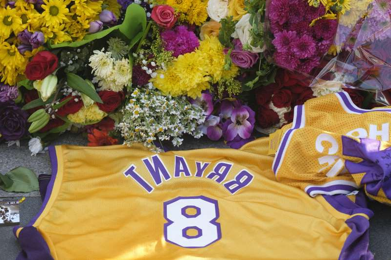 A memorial for Kobe Bryant near Staples Center Monday, Jan. 27, 2020, in Los Angeles. Bryant, the 18-time NBA All-Star who won five championships and became one of the greatest basketball players of his generation during a 20-year career with the Los Angeles Lakers, died in a helicopter crash Sunday. (AP Photo/Ringo H.W. Chiu)