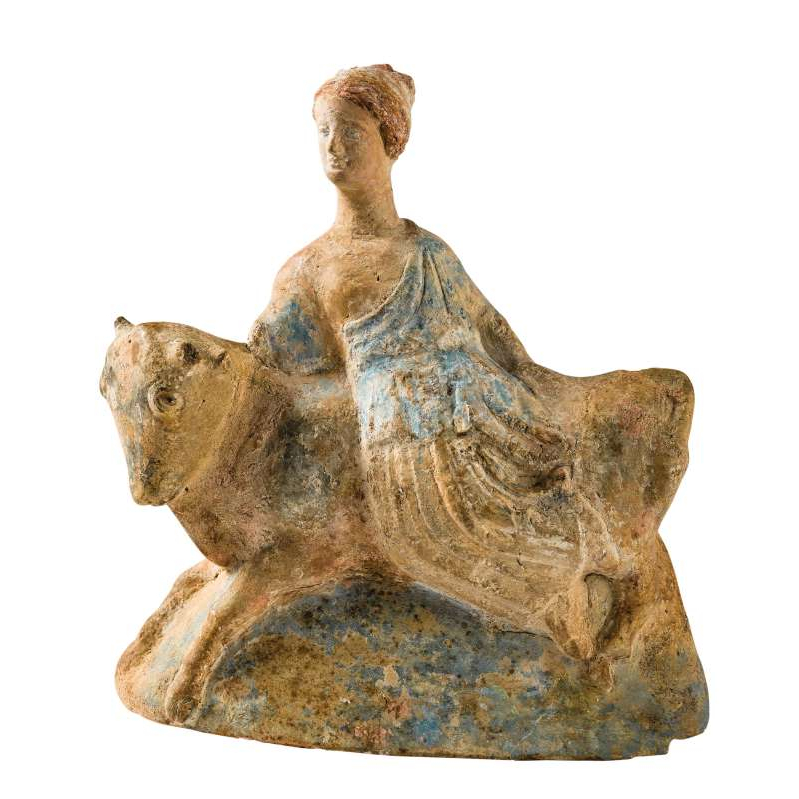 a close up of a rock: The Tanagra figures represented many ordinary scenes and everyday episodes, but they also depicted various mythological subjects such as the abduction of Europa, a Phoenician princess, by the god Zeus. He has taken the form of a beautiful bull, and she sits astride his back. The work retains part of its original polychrome, especially on the hair and clothing. Museum of Mediterranean Archaeology, Marseilles