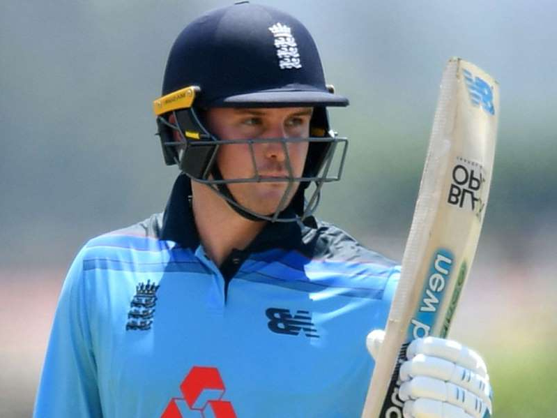 a man wearing a helmet holding a baseball bat: Opener Jason Roy scored 104 in England's 240 all out off 44.1 overs