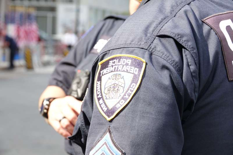 11 September 2019, US, New York: The New York City Police Department (NYPD) logo can be seen on a uniform during the 18th anniversary of the September 11, 2001 terrorist attacks near Ground Zero. Photo: Alexandra Schuler/dpa (Photo by Alexandra Schuler/picture alliance via Getty Images)
