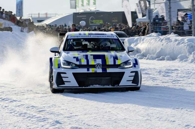 a car covered in snow: Volkswagen Golf eR1