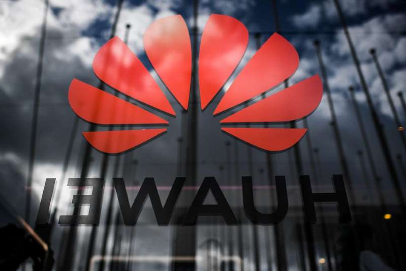a close up of a sign: Huawei is fighting an FCC action to label it a risk to US national security. Patricia De Melo Moreira/AFP via Getty Images