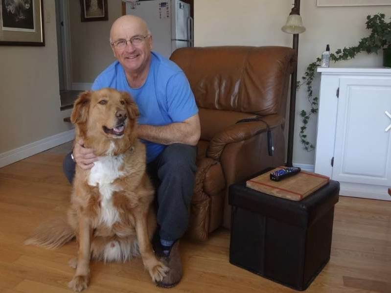 a man and a dog posing for the camera: Yvon Mercier is charged with two counts of second-degree murder and one count of arson.