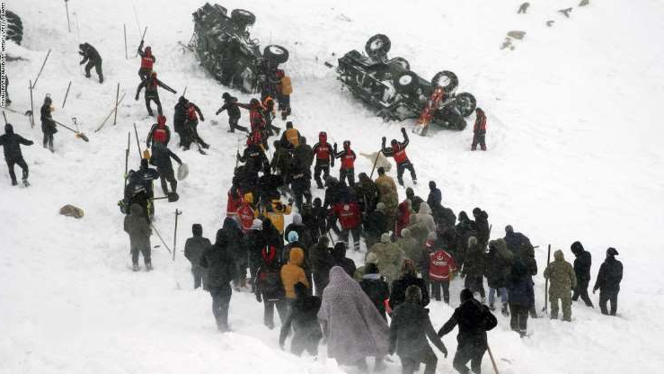 a group of people skiing on the snow: Search and rescue works continue after a second avalanche buries a search team in Turkey's  Van province on Wednesday.