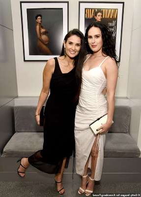 Rumer Willis et al. posing for the camera: Cover girl: Demi Moore, 57, posed in front of her iconic Vanity Fair cover as she joined her daughter Rumer, 31, at the opening of the Vanity Fair: Hollywood Calling exhibit at the Annenberg Space For Photography in LA's Century City neighborhood