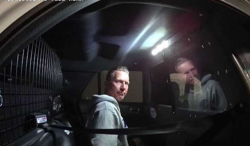 a man standing in front of a subway car: Body Camera Video