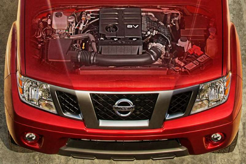 a black and red car: She's been around the block a few times, but there's a new heart beating under that hood. Nissan