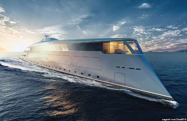 a boat on a body of water: The Aqua superyacht is a futuristic design that is 370ft-long, comprised of five decks, and runs off liquid hydrogen meaning it only emits water. Design studio Sinot said the exterior of the vessel was inspired by ocean swells, the movement of the tides, and weather out on the open ocean