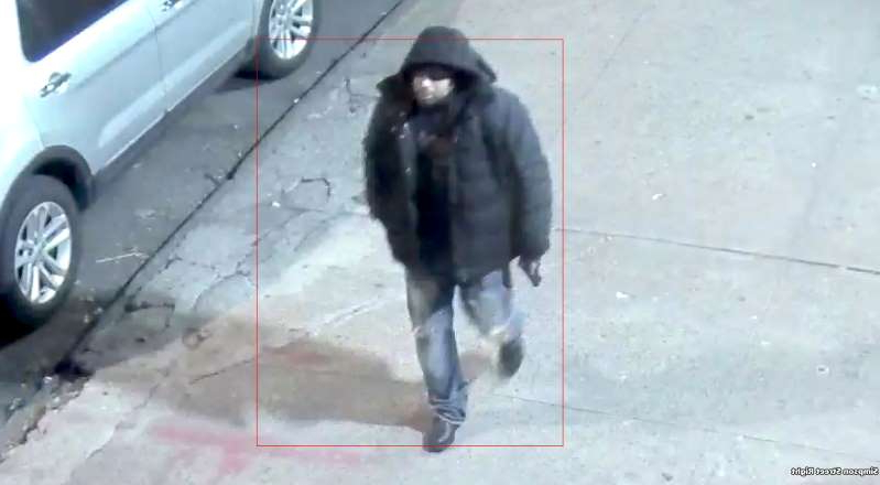 In this image taken from video provided by the New York Police Department a man, who the NYPD is seeking the public's assistance in identifying in connection to a police involved shooting, walks down a street on Saturday, Feb. 8, 2020, in New York. Two New York City police officers narrowly escaped with their lives when a gunman fired into their patrol van Saturday night, wounding one of them in an attack officials called an attempted assassination. (New York Police Department via AP)