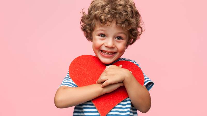 a little boy wearing a red shirt: valentines-day-classroom-activities-featured