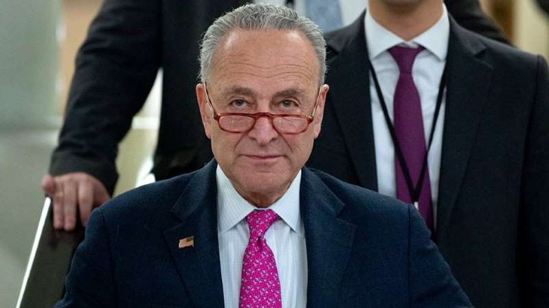 Chuck Schumer wearing a suit and tie: Schumer requests DOJ watchdog probe Roger Stone sentencing recommendation